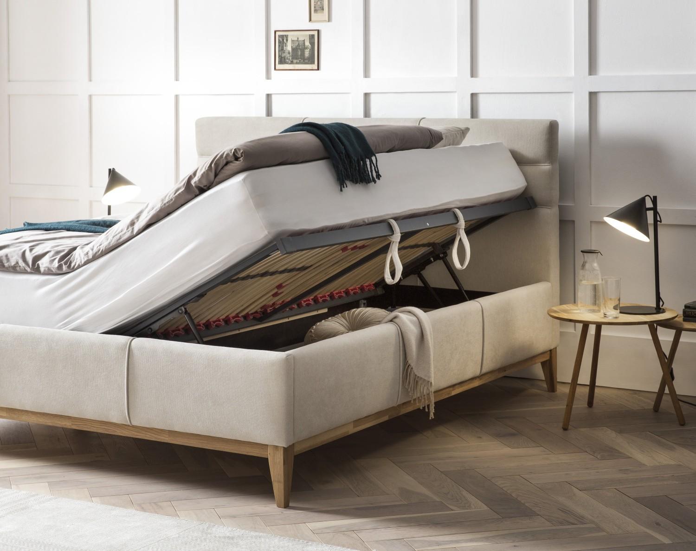 Kvalitná boxspring postel s úložným priestorom a lamelovým rostom svetlá látka