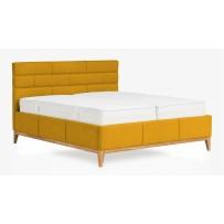 žltá box spring posteľ